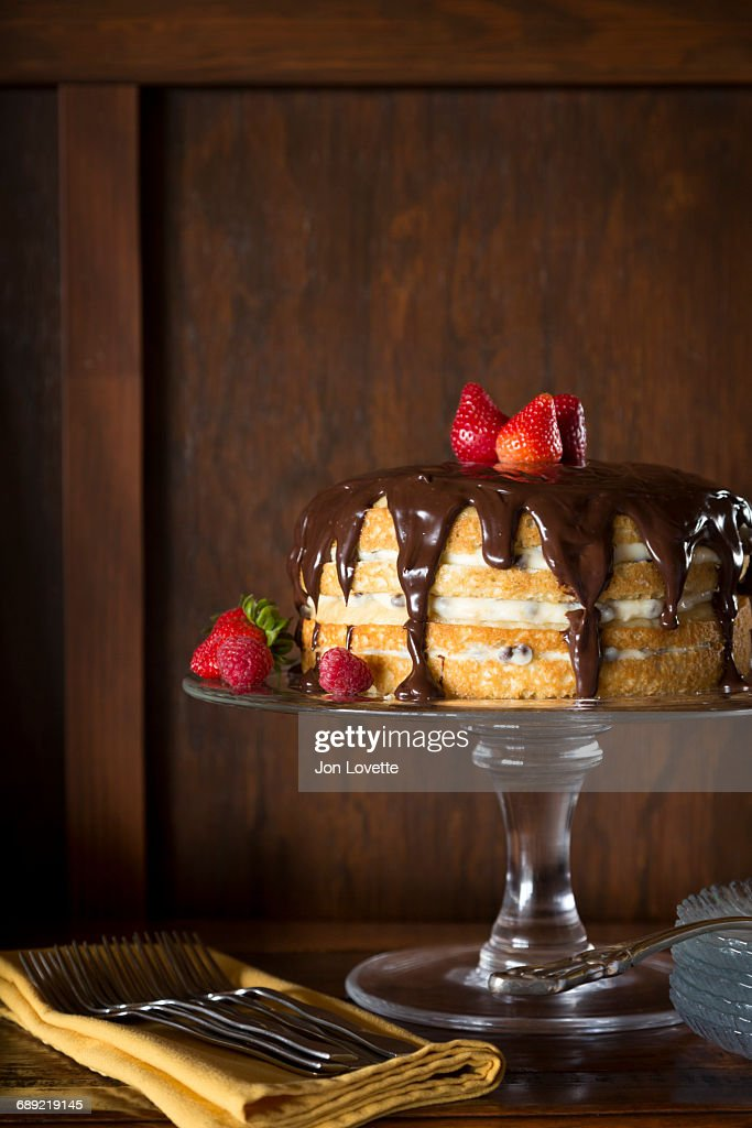 Cake with chocolate topping : Stock Photo