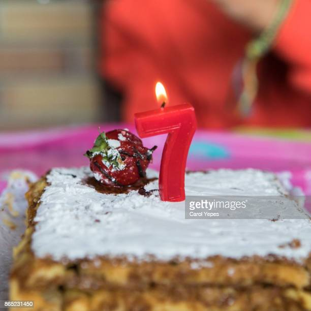 cake with number seven candle