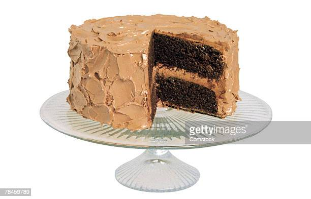 Cake with slice missing on stand
