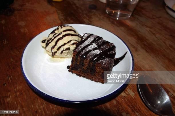 Cake with vanilla ice cream and chocolate sauce