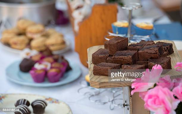 Cakes and jams on sale along with sausage sizzles on July 2 2016 in Sydney Australia Sausage sizzles have over time become an Australian tradition on...