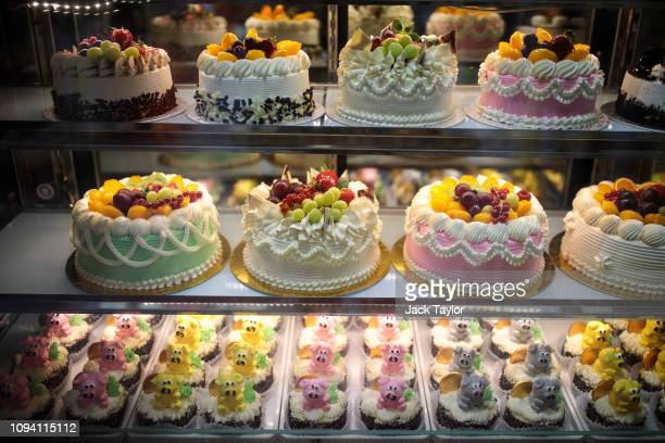 Cakes are displayed in a bakery on Chinese New Year in Chinatown on February 5 2019 in London England Chinese New Year the Year of the Pig a...