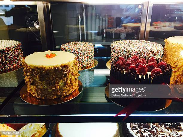Cakes On Display Cabinet At Bakery
