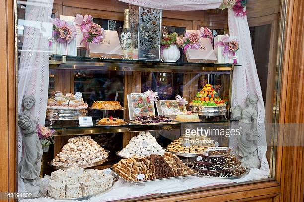 Cakes sweets andpastries in shop window of luxury patticeria caffe sweet shop Gilli established in 1733 in Florence Tuscany Italy