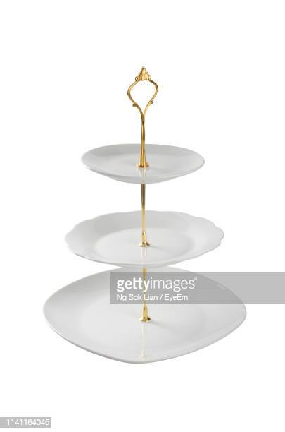 cakestand against white background - cakestand stock pictures, royalty-free photos & images