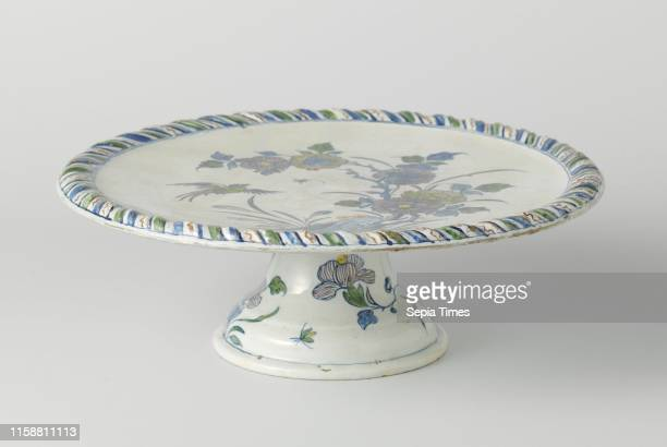 Cakestand around on foot multicolor painted with flowers and flying bird