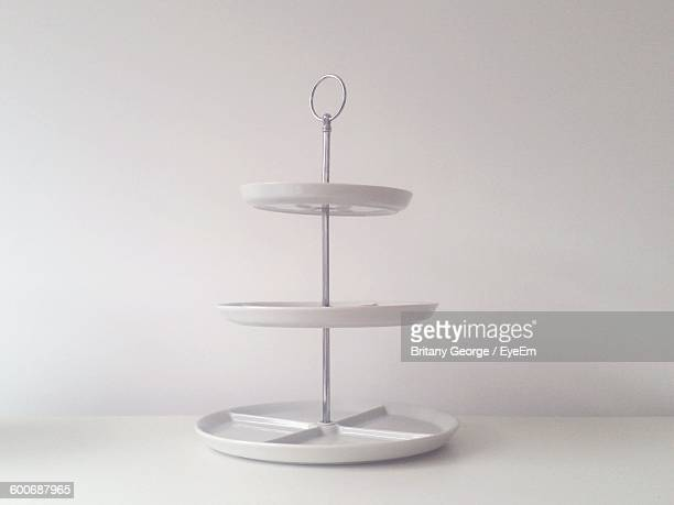 Cakestand On Table Against White Wall