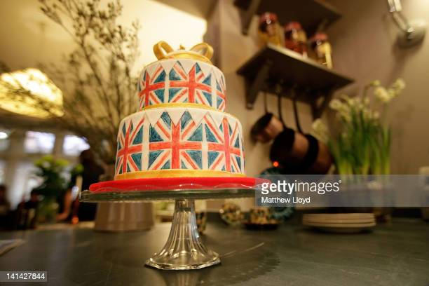 A cakestand rests in the kitchen of the Prince's Arts and Crafts House one of three show houses at the Ideal Home Show at Earls Court on March 16...