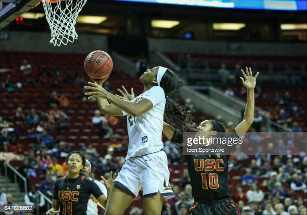 Cal Bears guard Mi'Cole Cayton drives to the hoop during the woman's Pac 12 college tournament game between the USC Trojans and the CAL Bears on...