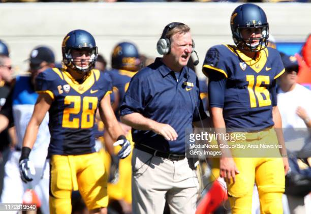 Cal Bears quarterback Jared Goff gets directions from offensive coordinator Tony Franklin in the first half of a football game against the Portland...