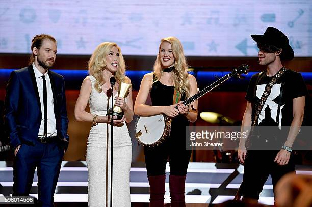 Cal Campbell Kimberly Campbell Ashley Campbell and Shannon Campbell speak onstage during the 10th Annual ACM Honors at the Ryman Auditorium on August...