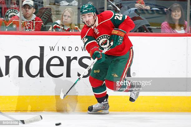 Cal Clutterbuck of the Minnesota Wild delivers a pass against the Ottawa Senators during the game at the Xcel Energy Center on February 14, 2009 in...