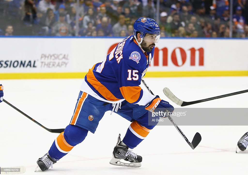 Cal Clutterbuck #15 of the New York Islanders in action against the Ottawa Senators during their game at the Nassau Veterans Memorial Coliseum on March 13, 2015 in Uniondale, New York.