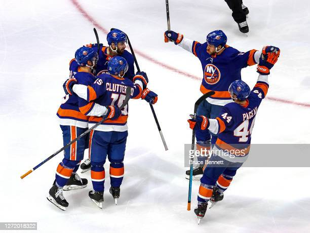 Cal Clutterbuck of the New York Islanders is congratulated by his teammates after scoring a goal against the Tampa Bay Lightning during the first...