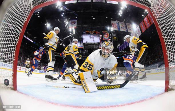 Cal Clutterbuck of the New York Islanders scores at 14:17 of the third period against Tristan Jarry of the Pittsburgh Penguins in Game Three of the...
