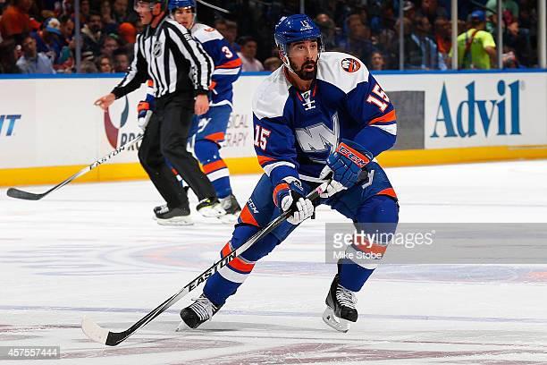 Cal Clutterbuck of the New York Islanders skates against the San Jose Sharks at Nassau Veterans Memorial Coliseum on October 16, 2014 in Uniondale,...