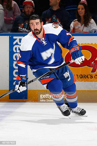 Cal Clutterbuck of the New York Islanders skates during warm-ups prior to their game against the San Jose Sharks at Nassau Veterans Memorial Coliseum...