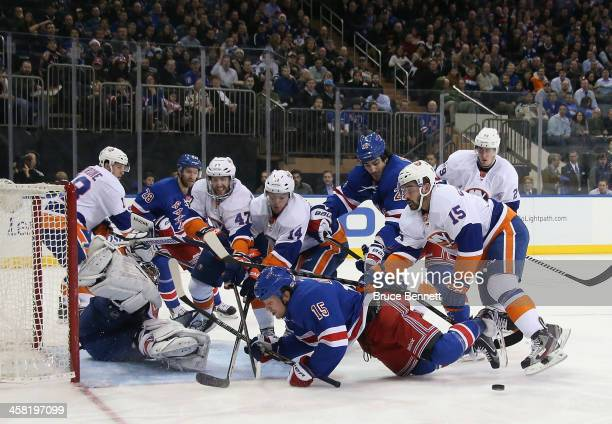 Cal Clutterbuck of the New York Islanders takes a two minute penalty for crosschecking Derek Dorsett of the New York Rangers during the second period...