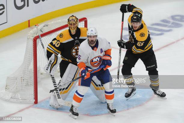 Cal Clutterbuck of the New York Islanders watches the play against Tuukka Rask and Jeremy Lauzon of the Boston Bruins in Game Two of the Second Round...
