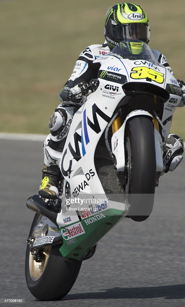 Cal Crutchlow of Great Britain and CWM LCR Honda lifts the front wheel during the MotoGp of Catalunya - Qualifying at Circuit de Catalunya on June 13, 2015 in Montmelo, Spain.