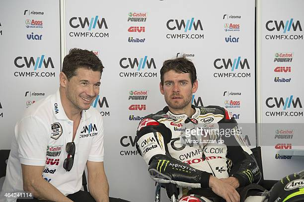 Cal Crutchlow of Great Britain and CWM LCR Honda speaks in box with Lucio Cecchinello of Italy during the MotoGP Tests in Sepang Day One at Sepang...