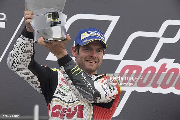 Cal Crutchlow of Great Britain and LCR Honda celebrates the second place on the podium at the end of the MotoGP race during the MotoGp of Germany...