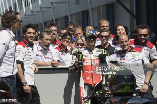 Cal Crutchlow of Great Britain and LCR Honda celebrates with team the second place at the end of the MotoGP Qualifying practice during the MotoGP...
