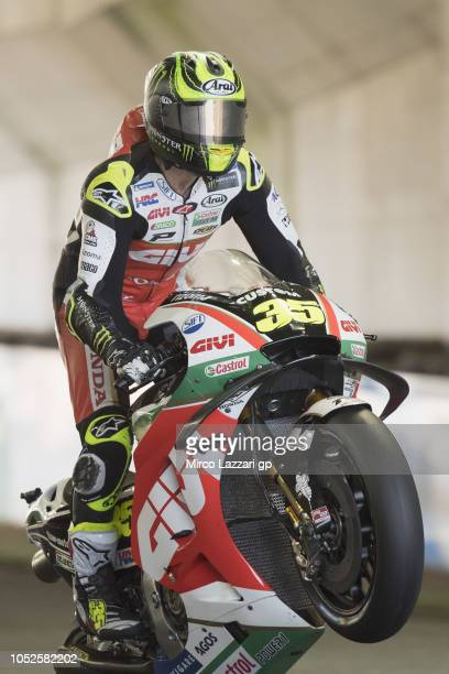Cal Crutchlow of Great Britain and LCR Honda lifts the front wheel during the MotoGP of Japan Qualifying at Twin Ring Motegi on October 20 2018 in...