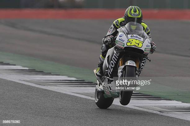 Cal Crutchlow of Great Britain and LCR Honda lifts the front wheel during the MotoGp Of Great Britain qualifying practice at Silverstone Circuit on...