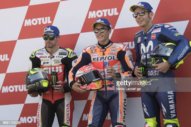 Cal Crutchlow of Great Britain and LCR Honda Marc Marquez of Spain and Repsol Honda Team and Valentino Rossi of Italy and Movistar Yamaha MotoGP pose...