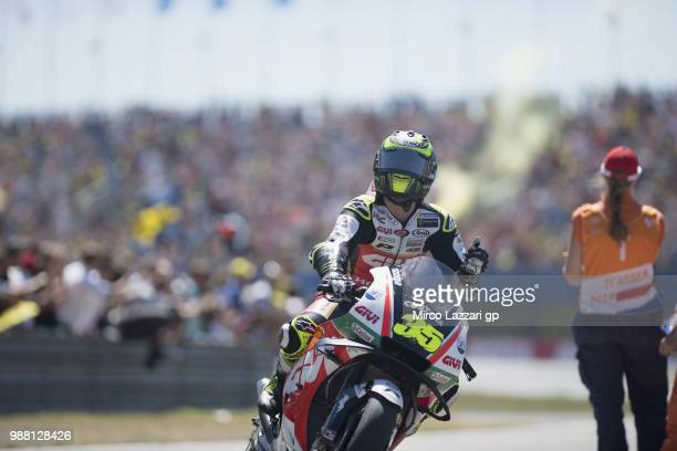 Cal Crutchlow of Great Britain and LCR Honda returns in box and greets the fans during the Qualifying practice during the MotoGP Netherlands...