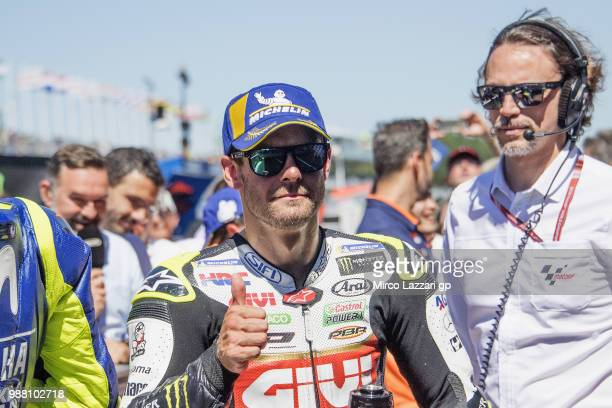 Cal Crutchlow of Great Britain and LCR Honda smiles and celebrates the second place at the end of the MotoGP Qualifying practice during the MotoGP...