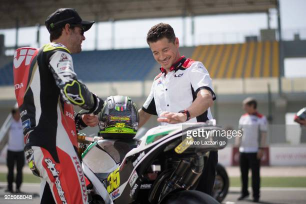 Cal Crutchlow of Great Britain and LCR Honda speaks with Lucio Cecchinello of Italy and LCR Honda MotoGP during the MotoGP Testing Qatar at Losail...