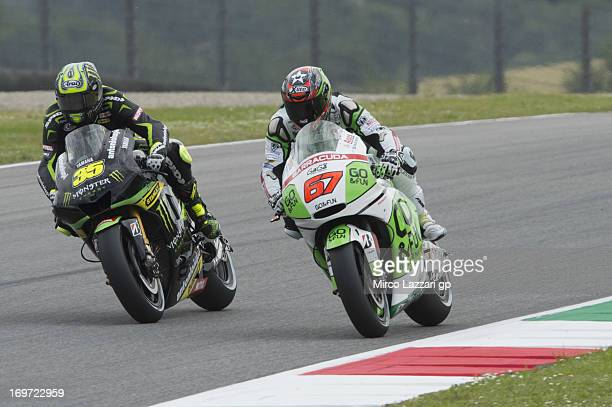 Cal Crutchlow of Great Britain and Monster Yamaha Tech 3 and Bryan Staring of Australia and GoFun FTR Honda Gresini head down a straight during the...