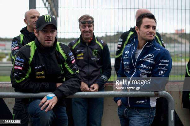 Cal Crutchlow of Great Britain and Monster Yamaha Tech 3 and Randy De Puniet of France and Power Electronics Aspar look on in pit during the second...