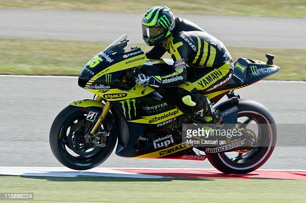 Cal Crutchlow of Great Britain and Monster Yamaha Tech 3 lifts the front wheel during the qualifying practice of MotoGP of Great Britain at...