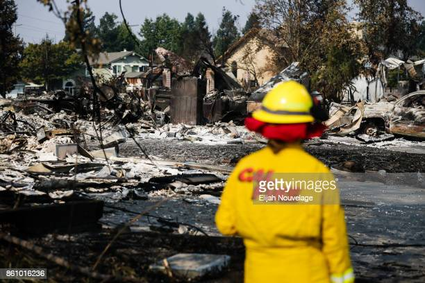 Cal Fire employee surveys damage in the Coffey Park neighborhood caused by the Tubbs Fire on October 13 2017 in Santa Rosa California Twenty four...