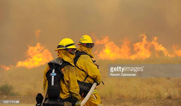 Cal Fire firefighters battle the Crown Fire which continues to burn on July 30 2010 in the hills above Palmdale California The 8000acre Crown Fire is...