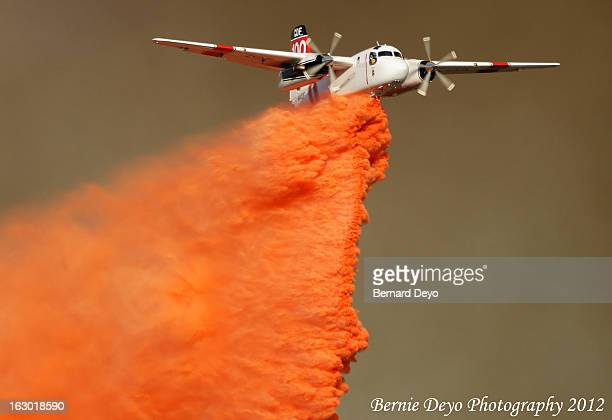 Cal Fire S-2, Tanker 100 makes a beautiful drop in on the fires western edge.