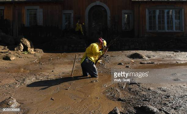 MONTECITO CA JANUARY 10 Cal Firefighter Alex Jimenez finds blood seeping from the mud at a house along Glen Oaks Drive in Montecito after a major...