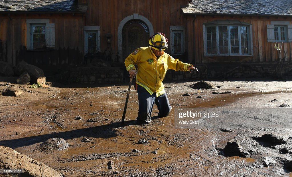 MONTECITO, CA - JANUARY 10 - Cal Firefighter Alex Jimenez walks out after finding a body under the mud at a house along Glen Oaks Drive in Montecito after a major storm hit the burn area Wednesday on January 10, 2018 in Montecito, California.