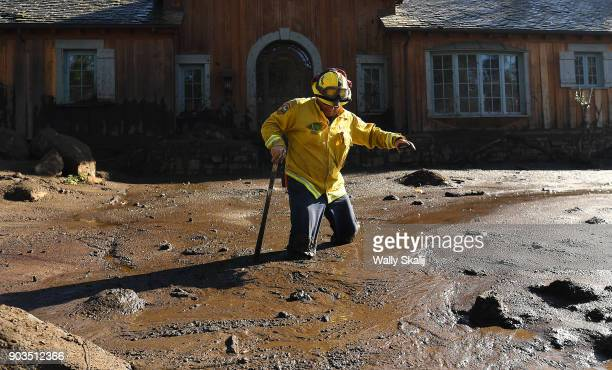 MONTECITO CA JANUARY 10 Cal Firefighter Alex Jimenez walks out after finding a body under the mud at a house along Glen Oaks Drive in Montecito after...