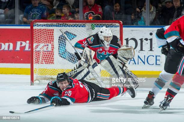 Cal Foote of the Kelowna Rockets slides to block the shot on Roman Basra of the Kelowna Rockets during first period against the Kootenay Ice on...