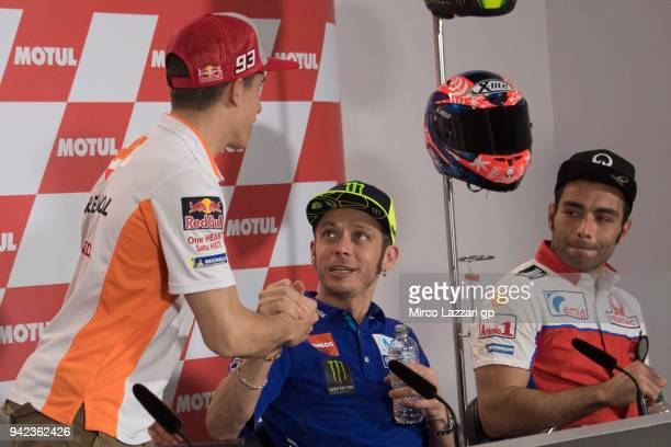 Cal Marc Marquez of Spain and Repsol Honda Team greets Valentino Rossi of Italy and Movistar Yamaha MotoGP during the press conference preevent...