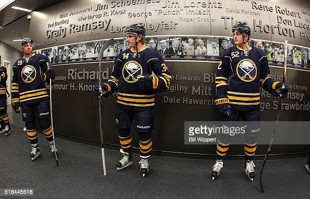Cal O'Reilly Casey Nelson and Hudson Fasching of the Buffalo Sabres prepare to play the Toronto Maple Leafs in an NHL game on March 31 2016 at the...