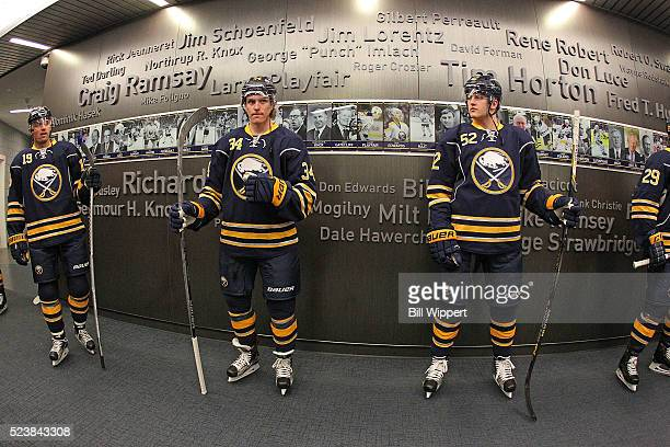 Cal O'Reilly Casey Nelson and Hudson Fasching of the Buffalo Sabres head to the ice to play the Toronto Maple Leafs in an NHL game on March 31 2016...