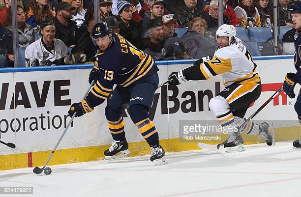 Cal O'Reilly of the Buffalo Sabres battles the for the puck against Matt Cullen of the Pittsburgh Penguins during an NHL game at the KeyBank Center...