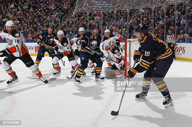 Cal O'Reilly of the Buffalo Sabres looks to pass the puck to teammates while being defended by the Anaheim Ducks during an NHL game on December 17...