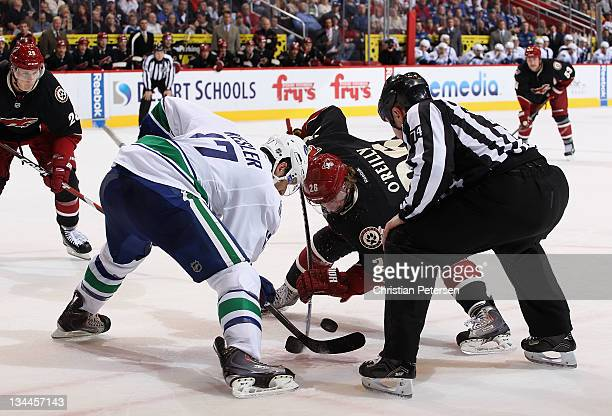 Cal O'Reilly of the Phoenix Coyotes faces off against Ryan Kesler of the Vancouver Canucks during the NHL game at Jobingcom Arena on November 25 2011...