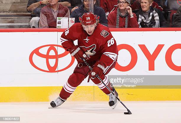Cal O'Reilly of the Phoenix Coyotes skates with the puck during the NHL game against the Boston Bruins at Jobingcom Arena on December 28 2011 in...